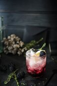 Bramble cocktail made with gin, blackberry liqueur and lemon