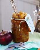 Homemade apple chutney in a glass jar as a gift