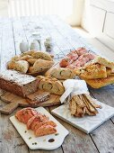 Various homemade breads and homemade pastries on a wooden table