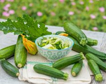 Courgettes and a courgette salad on a garden table