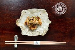 Kaiseki menu: Chinese soft turtle in a bowl with chopsticks