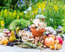 An autumnal arrangement of fruits, vegetables, mushrooms and nuts