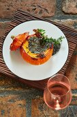 A whole braised Hokkaido pumpkin filled with amaranth and mountain cheese risotto