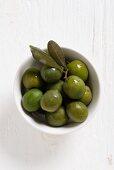 Dolce di Napoli olives in a white bowl
