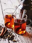 Two glasses of chai tea with spices