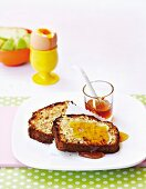 Banana bread with oats and coconut spread with butter and honey