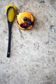 A berry muffin filled with lemon curd