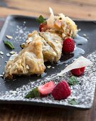 Baklava with pistachio nuts, raspberries and green tea