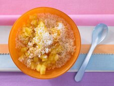 Millet and coconut muesli with fresh pineapple (seen from above)
