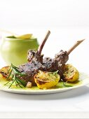 Marinated lamb chops with lemon potatoes from a barbecue
