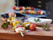 Chicken and vegetable kebabs with a yoghurt and mint dip