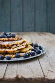 A stack of lemon buttermilk waffles with blueberries