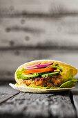 A gluten-free veggie burger in unleavened bread
