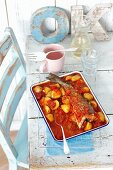 Oven-baked cod with chorizo, potatoes and tomatoes