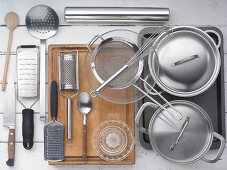 Kitchen utensils for making oven baked sweet potatoes and baby spinach