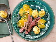 Thick flank of venison with orange and mustard potatoes