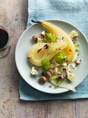 Poached pear with Stilton, celery and nuts