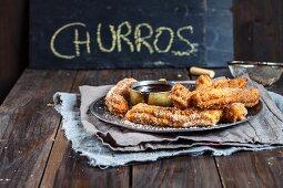 Churros with chocolate sauce (Spain)