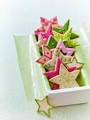 Colourful Christmas star biscuits in a gift box