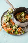 Gnudi (ricotta dumplings) with spinach and basil on tomato sugo
