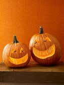 Two Halloween pumpkins with scary faces