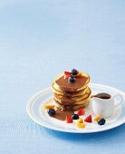 Pancakes with chocolate sauce and fruit