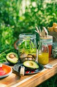 Layered Caesar salad in a preserving jar for a picnic
