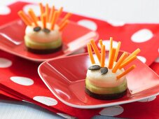 Cheese hedgehogs with carrot stick prickles and pumpkin seed eyes