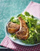 Grilled lamb chops with mint and pea puree and spinach leaves