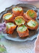 Potatoes wrapped in smoked salmon with dill