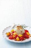Panna cotta with rosemary and apricot & cherry tomato compote