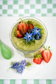 Vegan overnight oats with matcha, coconut milk, chia seeds and berries