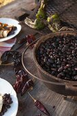 Black beans in a cast iron pot as ingredients for burritos on a table outdoorson