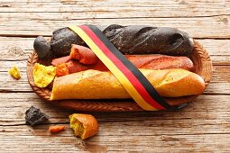 Baguettes – black, red and gold – tied with a ribbon