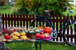 An autumnal buffet on a wooden table in a garden