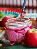 Chioggia beets in vinegar in a preserving jar