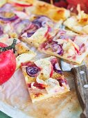 Spicy puff pastry tray bake cake with apples, onions and bacon