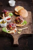 Vegan burger with cucumber relish, ketchup, mustard and red onions