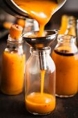 Pumpkin and chilli flake sauce in small glass bottles