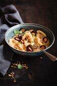 Vegan macaroni with cheese, pumpkin, carrot and onion