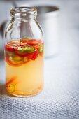 Vegan chilli sauce in a glass bottle