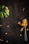 Sweet dumpling pumpkin with pulp and pumpkin seeds