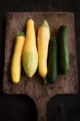 Yellow and green zucchinis on a chopping board