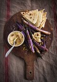 Grilled aubergines with houmous and flat bread