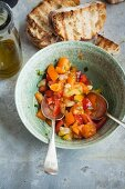 Colourful tomato salad with toasted bread