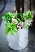 Green superfood vegetables in a paper bag