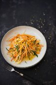 Raw vegetables strips with carrot, orange, and peppermint (vegan, detox)