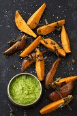 Oven cooked sweet potato wedges with avocado cream (vegan)