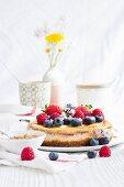 A whole, fresh berry cheesecake