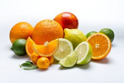 An arrangement of citrus fruits on a white surface
